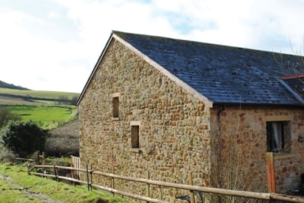 Acorn Barn with Rolling Hills to the Sea behind