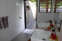 Bure bathroom with outdoor shower.