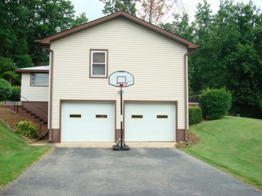 A garage for the car, ping pong table and basketball goal