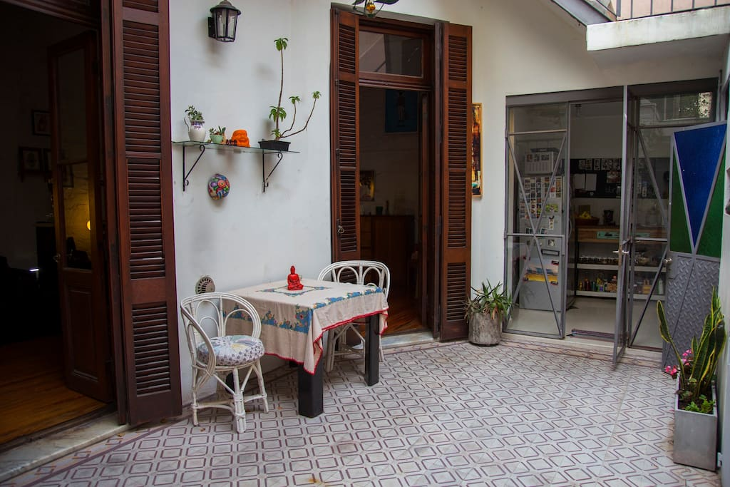 patio at the first floor that comunicates with the main living room, kitchen and one bathroom