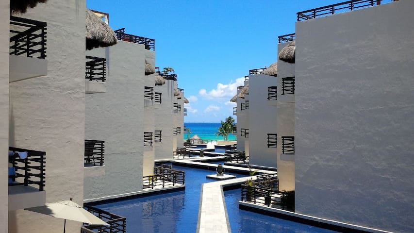Amazing view of the Caribbean Sea from one of the common areas perfect for relaxing reading, or working on your laptop.