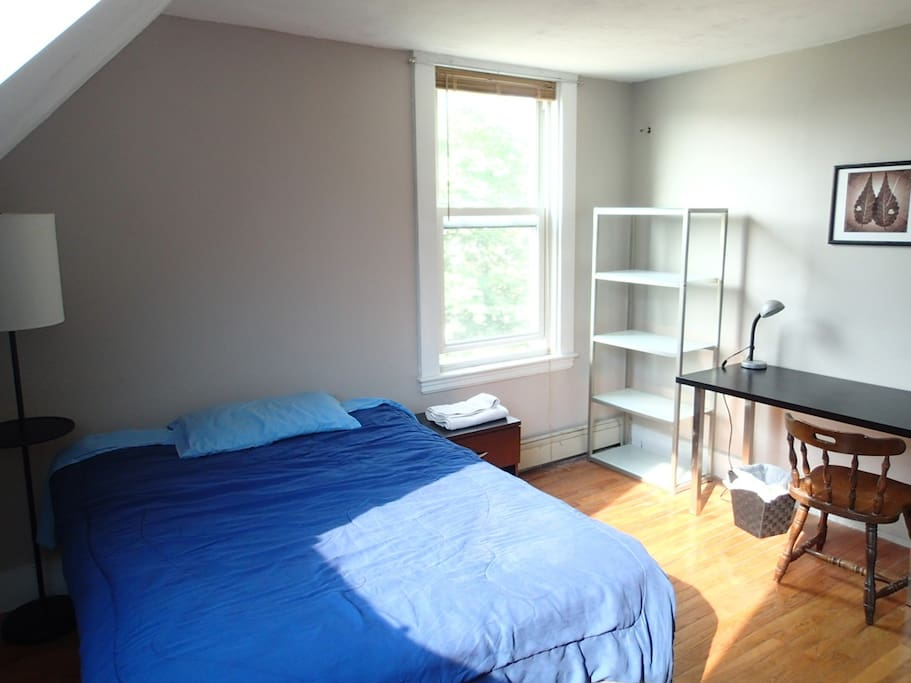 Full size bed. Window looks south, to the street. It can get warm during the day.