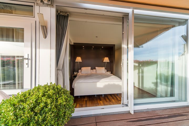 Bedroom with view/access to terrace