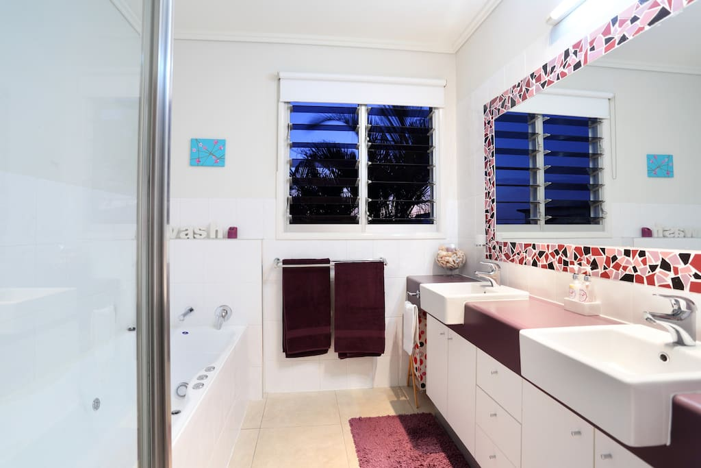 Double Bathroom with spa bath and shower. Separate toilet