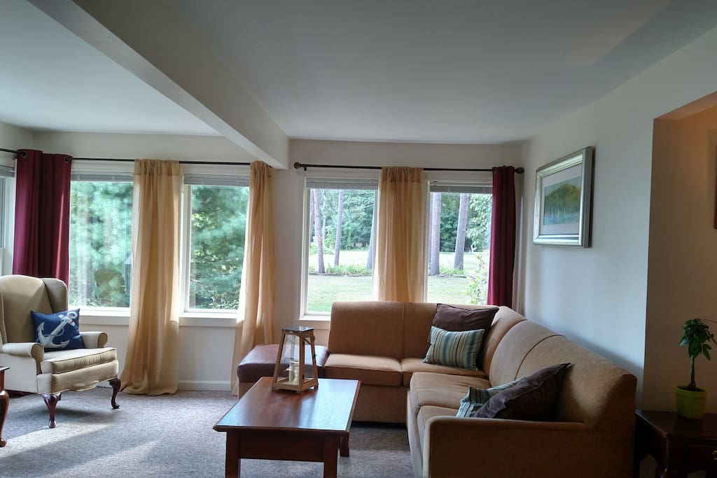 Sunlit living room overlooking Saratoga Lake and park like setting.