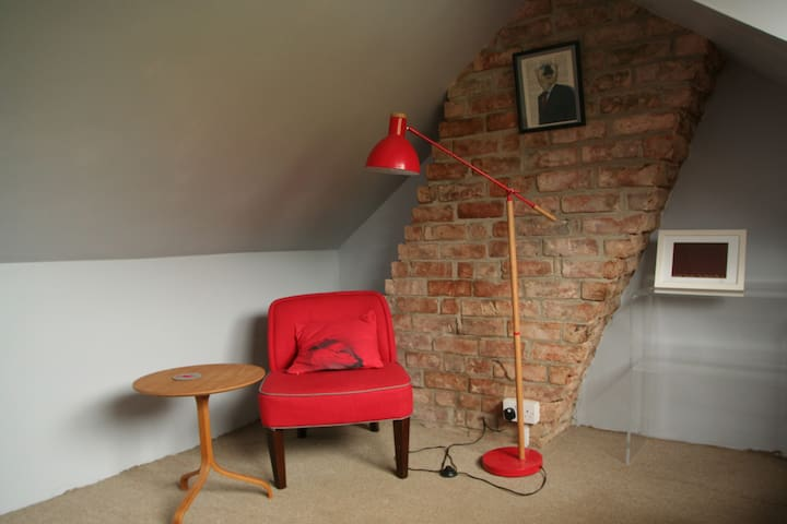 the attic room gets the morning sun and is the room with a view, a great place to relax with a book and a glass of wine.