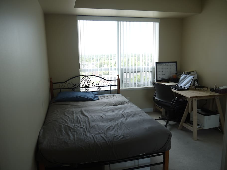 Bedroom #1: double bed and desk