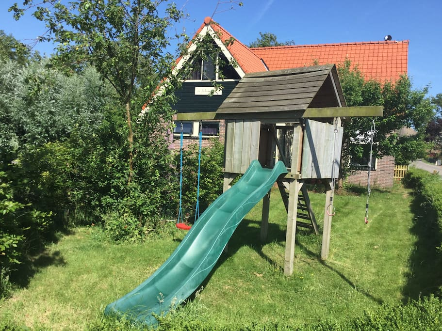 Play house with swing and slide.