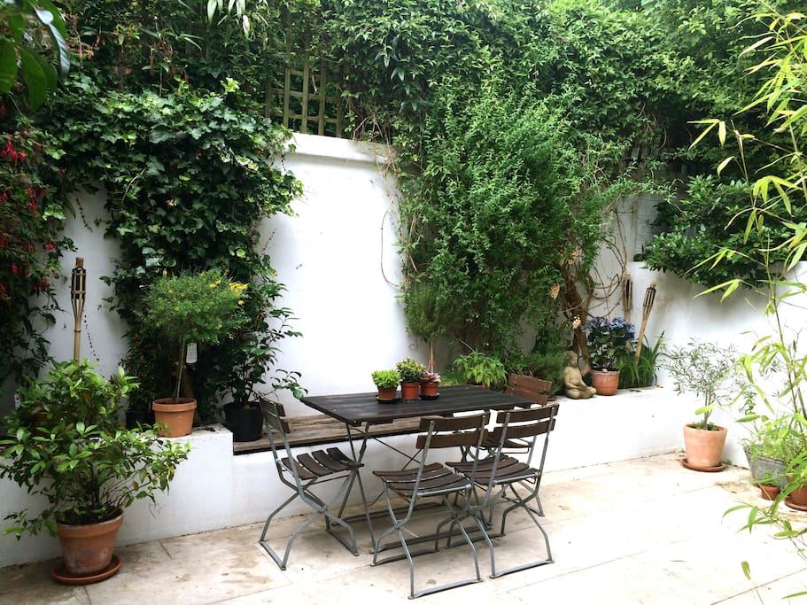 courtyard garden with outside table, sun loungers and bbq