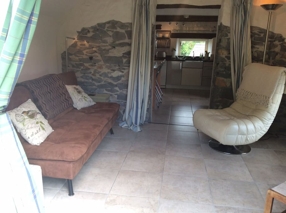 The upstairs lounge with comfie bed settee