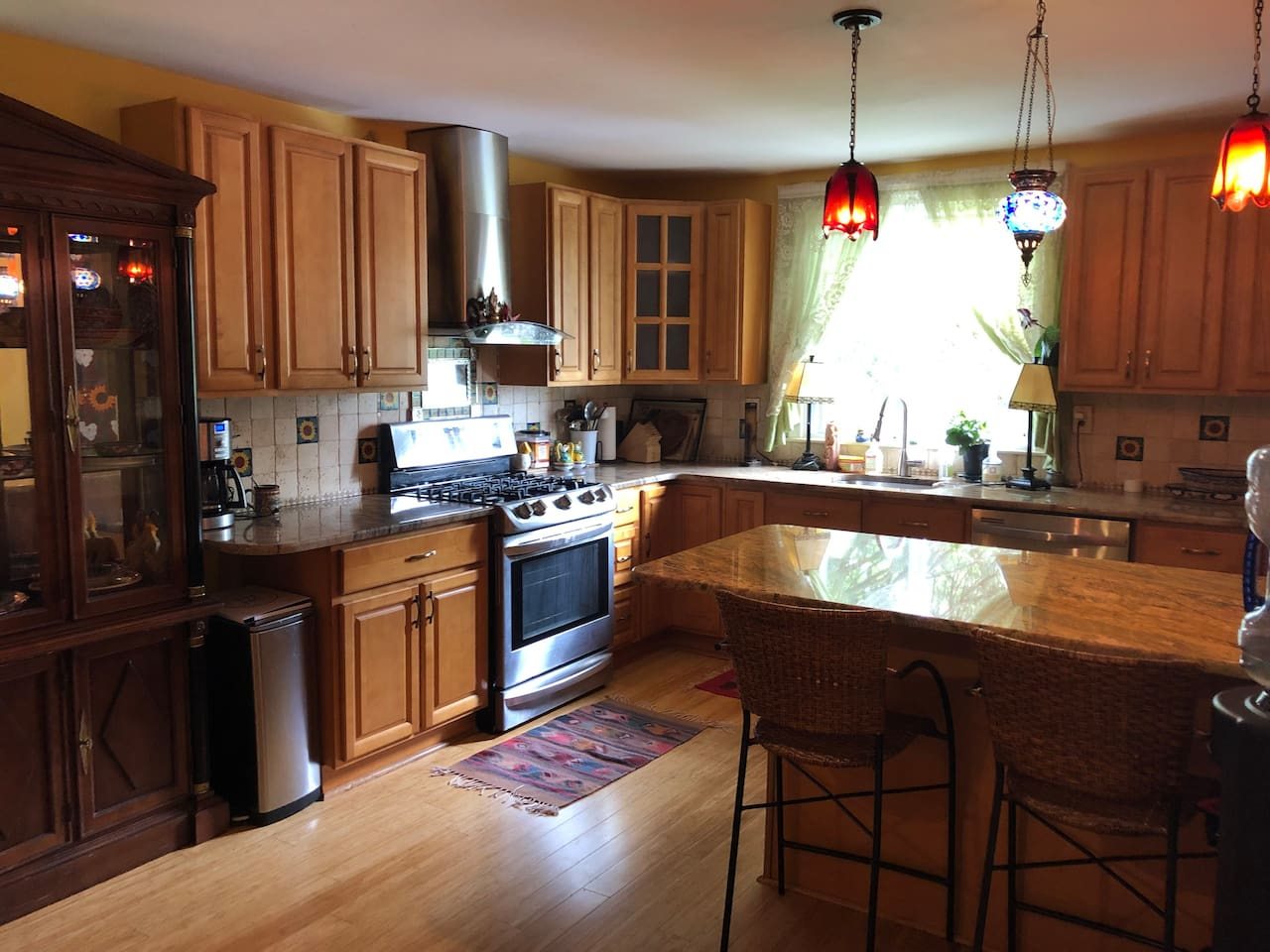 State of the art kitchen: chef's paradise. Best stocked kitchen you will ever find. 5 burner stove, large refrigerator, granite countertop and island, all spices, cooking supplies and cooking equipment: blender, food processor, coffee maker, and more