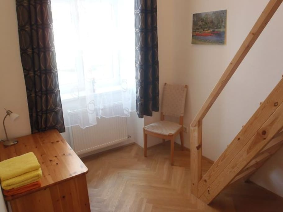 Bedroom with stairs to gallery