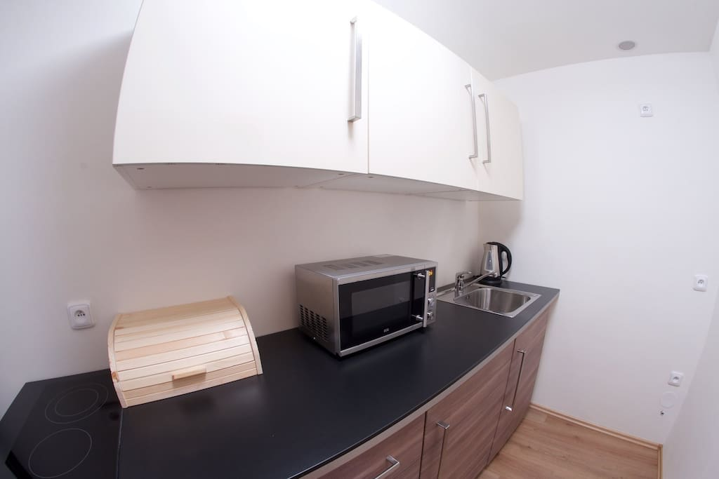 sink, microwave, stove and all the amenities to make a snack. Supermarket is just minutes away