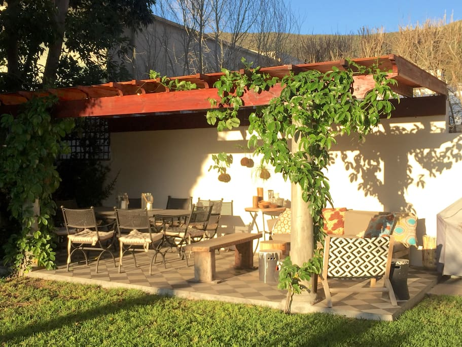 Undercover patio area for relaxing & eating with gorgeous granadilla vine.