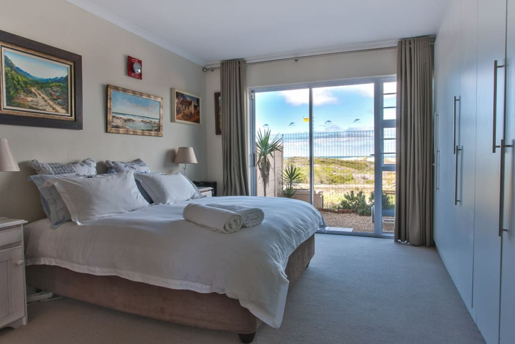 Main bedroom, en suite bathroom, sliding door leading onto small garden, sea facing