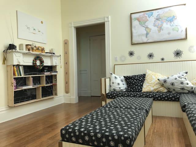Living room looking into hallway and bathroom door.