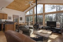 Beautiful sun drenched open plan lounge/ dining/ kitchen with wood burning fireplace!