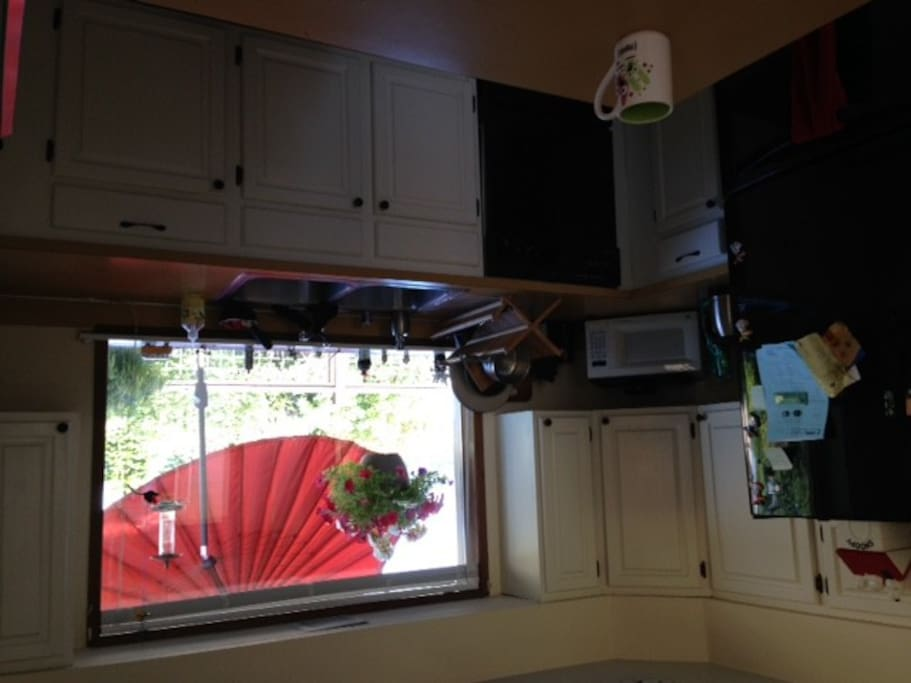 West facing (fully equipped!) kitchen with Puget Sound water view.