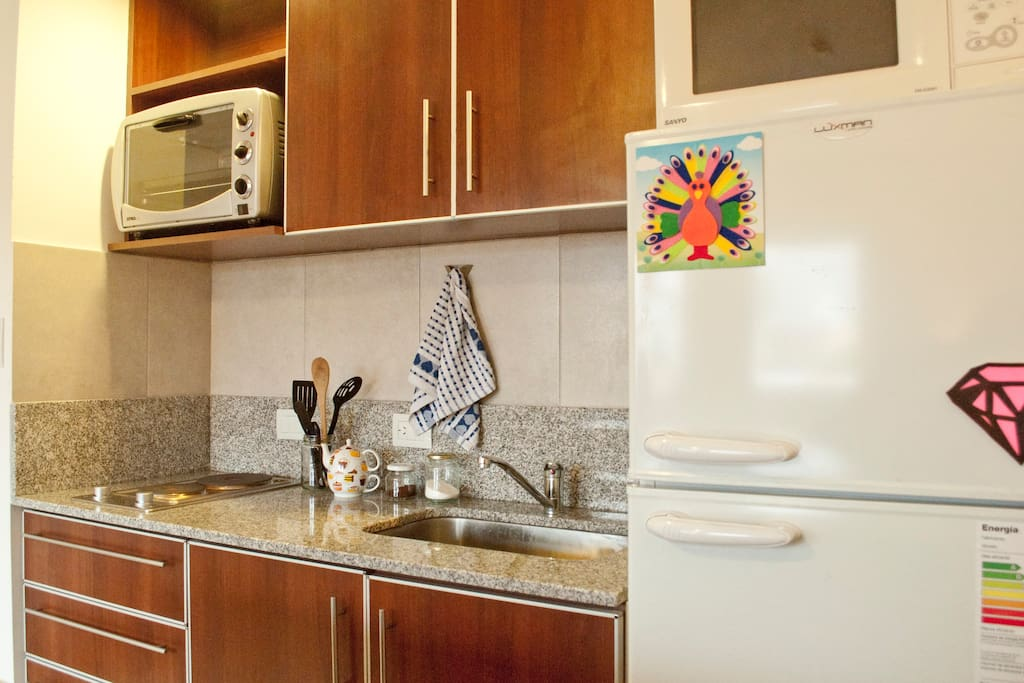 spacious fridge with freezer, coffee maker, blender, stove and electric oven