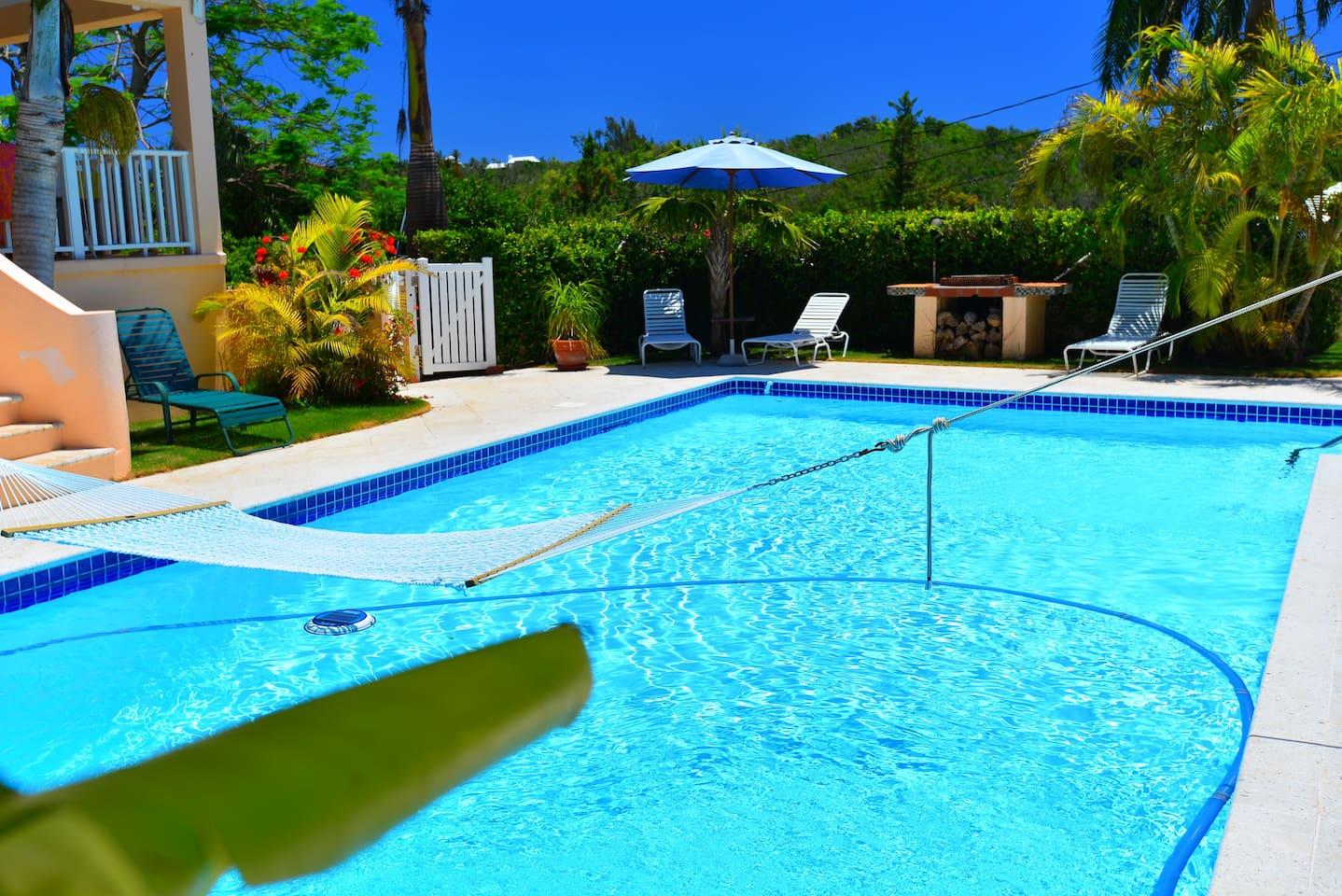 Relax in a lounger by the pool - or in the hammock over the pool!!