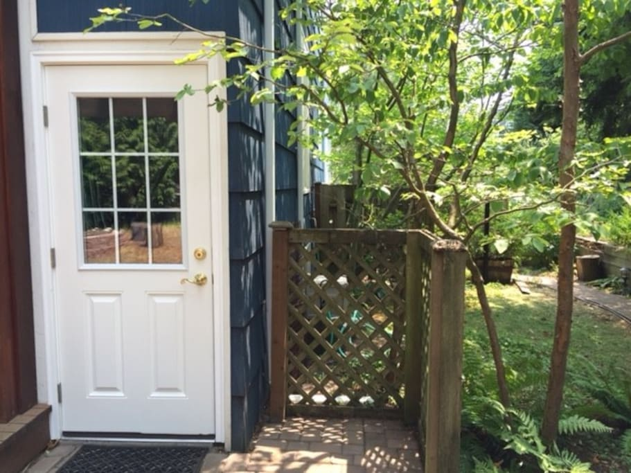 Private entrance located in wooded backyard.