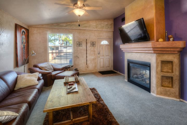 Cuddle up on the couch in front of the fireplace and TV in the cozy living area.