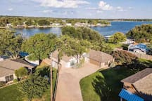 Ariel view of home showing plentiful parking and lake in background