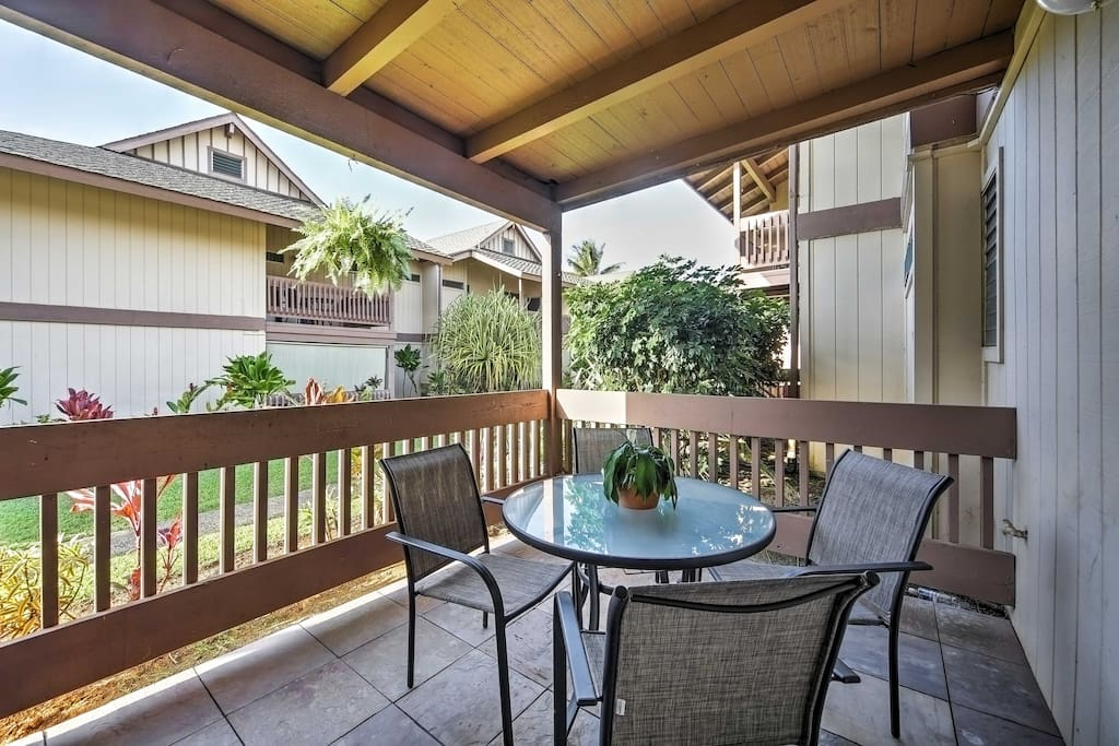 The ground-floor unit features a private lanai with outdoor furniture, ceiling fan and portable Vornado air circulator.