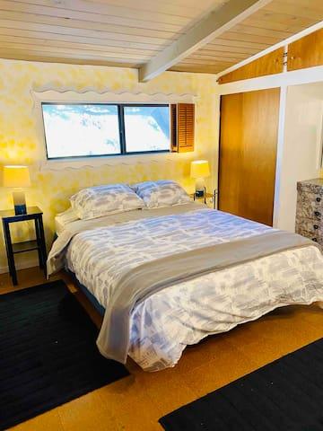 2nd floor bedroom with queen bed.