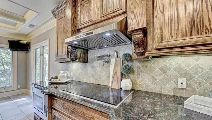 The kitchen is huge and fully loaded with Wolf Stove, KitchenAid appliances, Cuisinart etc. We have spices and oils and other extras.
