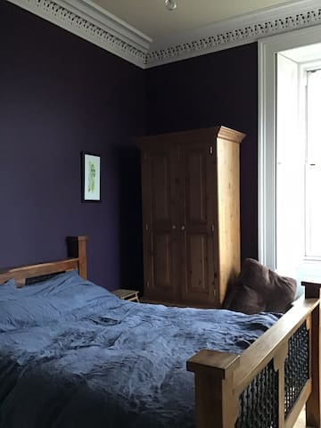 Peaceful double room with extensive views.