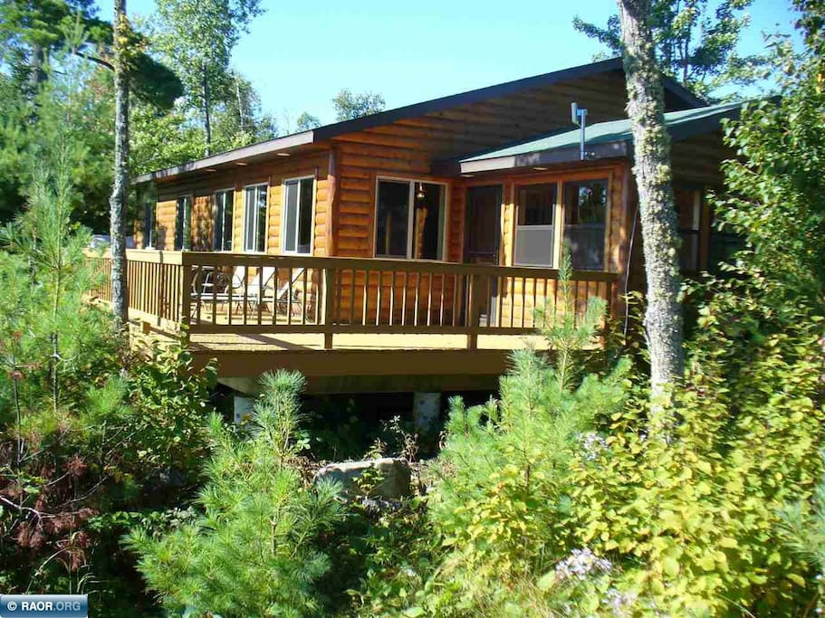 View of the back of cabin.  Your view would be of the lake and trees.