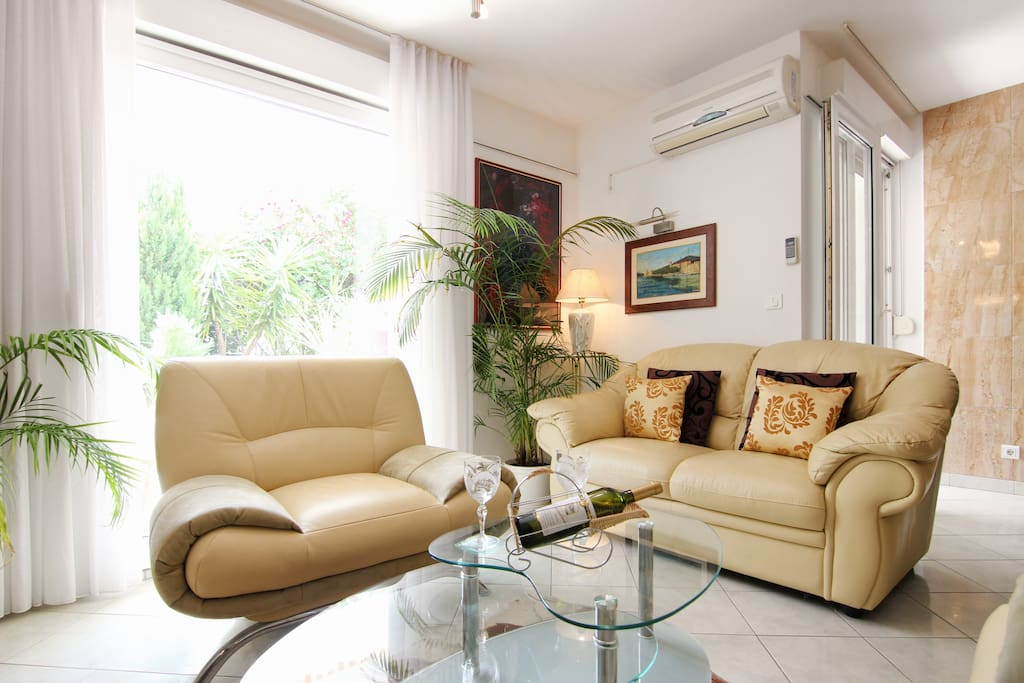 living room with LCD TV and air conditioning
