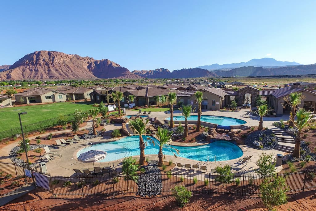 Large community pool with water slide and jacuzzi.