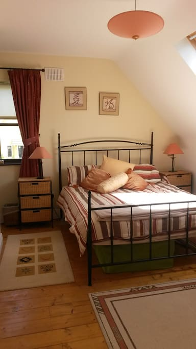 Bright spacious King bedroom with wardrobe, bedside lockers and drawers.