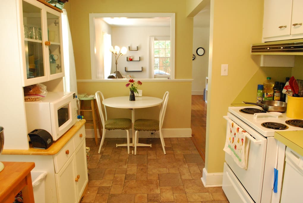 Kitchen with complimentary breakfast, coffee and tea, and cooking supplies.