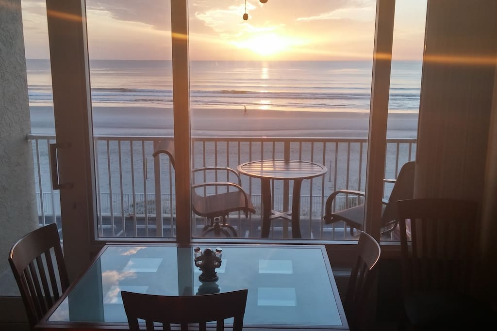 Sunrise, showing dinning table and High Top Furniture on theprimate balcony.