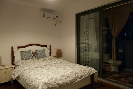 秋彤  万达商圈温馨浪漫干净大床房独立卫浴你可能与他人共用厨房及过道 - Zhenjiang - Huoneisto