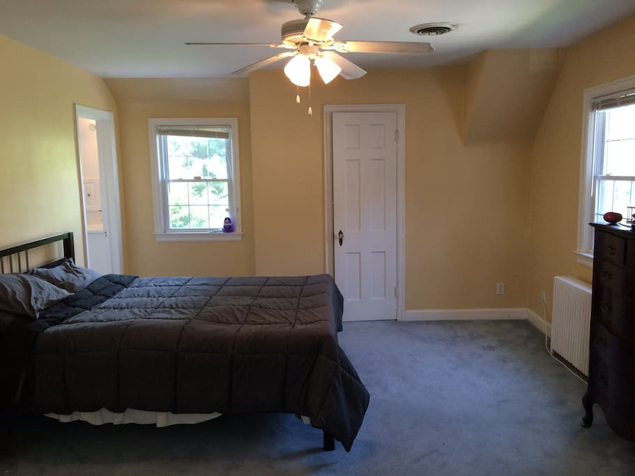 Queen sized bed and windows on the north and east wall. Doorway leads to private bath.