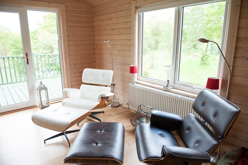 Two Eames chairs to relax in en enjoy the views. If you are lucky you will see a deer they frequent the grounds often.