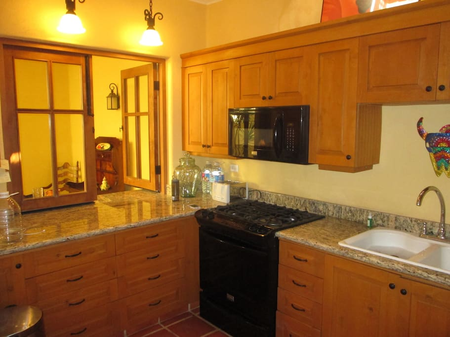 A fully appointed kitchen with dishwasher and microwave.