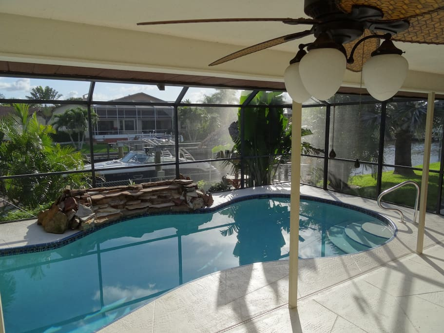 Refreshing heated salt water pool with large lanai area with table and 6 chairs for dinner outside (not in photo); pool screen room enclosure