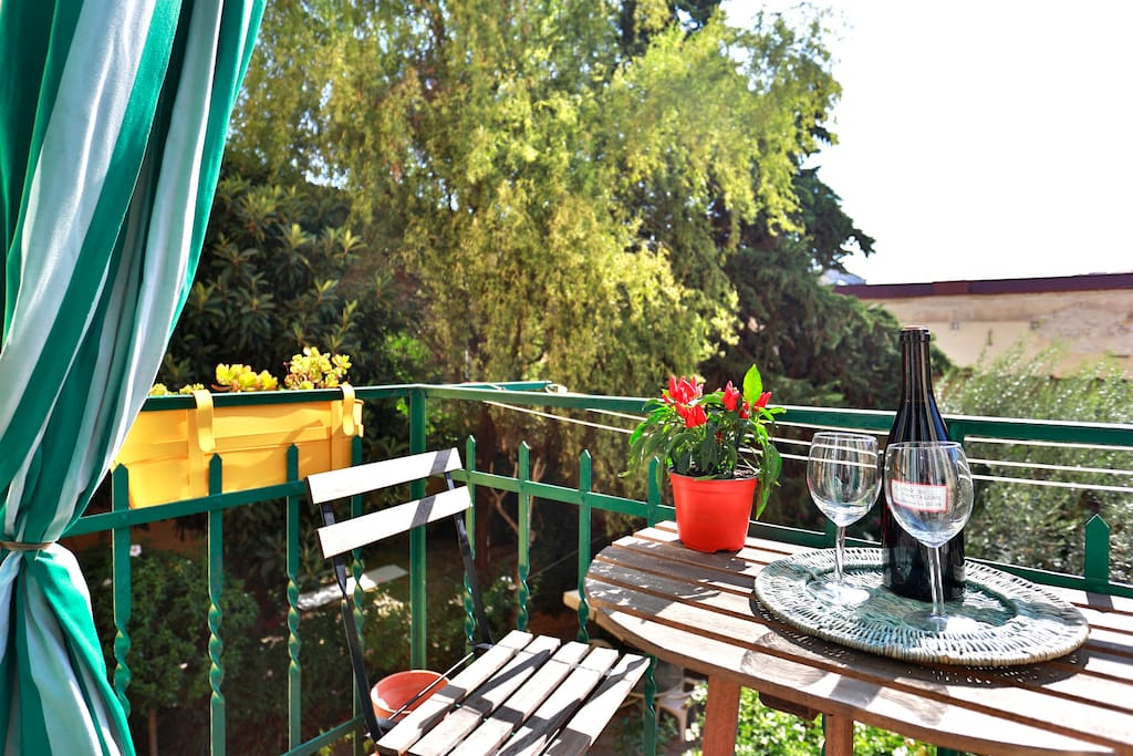 Relaxing in terrace with a glass of wine