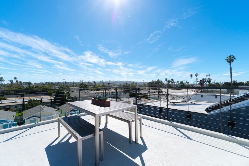 Grill and enjoy dinner on the roof deck with this family picnic table.
