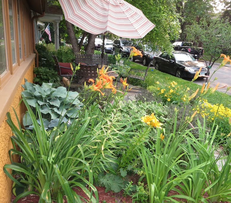 Beautiful front garden with patio seating - perfect for morning coffee overlooking the lake