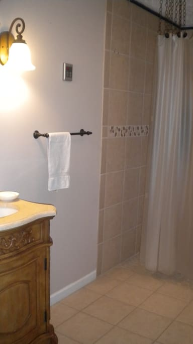 Bathroom has a shower accessible to those with mobility impairments.