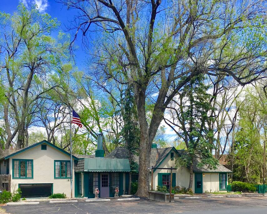 Mature trees surrounding home, plenty of parking, French windows throughout