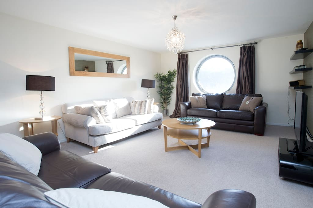 Lovely lounge has view of river, TV, DVD, iPod docking station, loads of seating