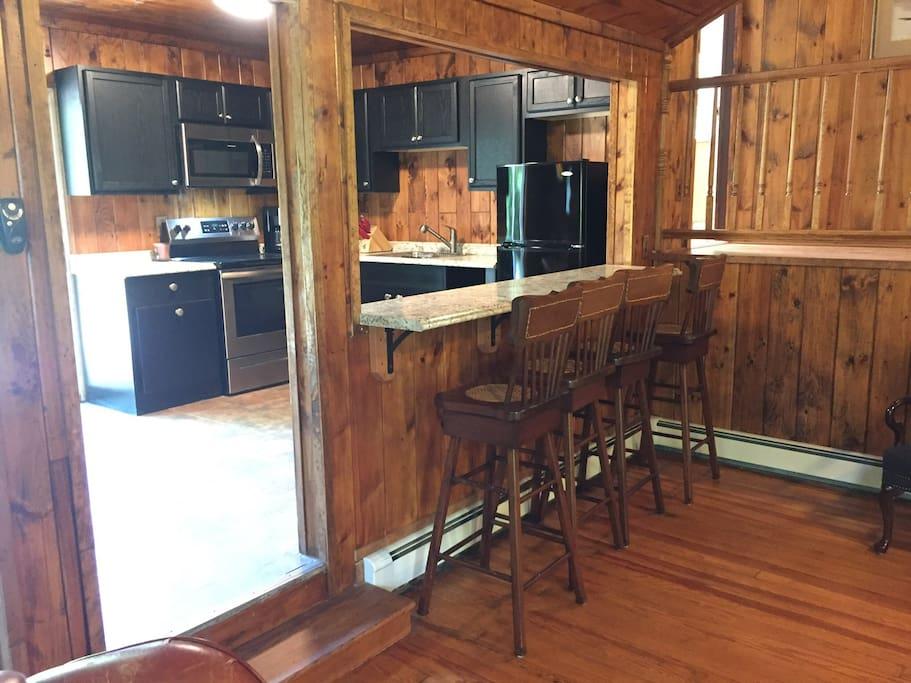 Spacious kitchen with bar area.  Kitchen opens to rear patio through sliding doors.