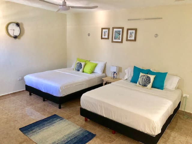 We believe quality sleep is important during the holidays. The room has two quality queen beds for a good and deep sleep. The room has AC for those hot days. Nice and clear decor.